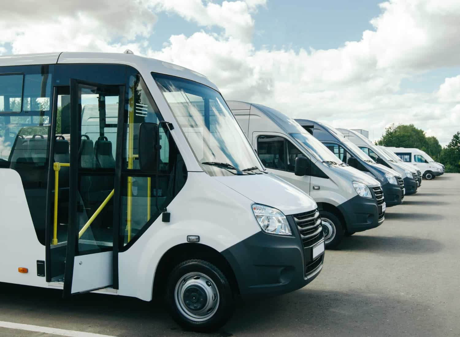 stock-photo-number-of-new-white-minibuses-and-vans-outside-beautiful-white-clouds-1414471718-mini-bus