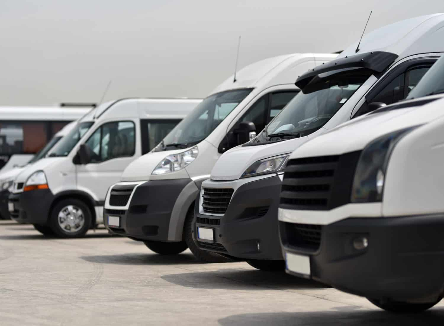 stock-photo-rental-service-of-minibus-and-small-bus-white-microbuses-parked-in-row-1428461072-microbus
