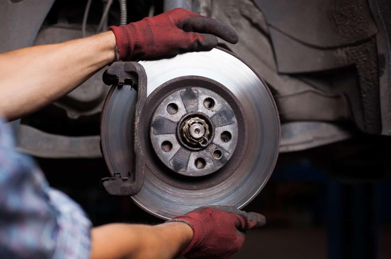 stock-photo-repairing-brakes-on-car-148283270